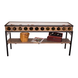 Napa East Collection - French Glass Top Console Table - The French Glass Top Console Table is a stunning console table wine display rack for the discerning wine connoisseur with 12 circular wine caverns and a glass top to reveal the labels and a shelf below. This artisan piece is crafted from rough hewn white oak from salvaged wine barrels, bracing made from retired wine barrel hoops, and an elegant distressed finish.