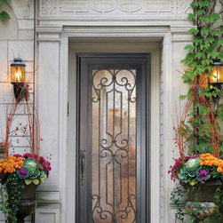 GlassCraft's Buffalo Forge Steel Single Door in Milano design - Buffalo Forge Single Entry Door in Milano wrought iron grille design finished in Antique Bronze color