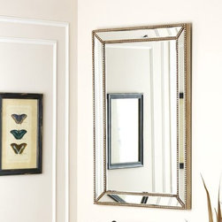 Cosmic Rectangle Wall Mirror - 24W x 47H in. - A modern wall accent with a distinctive decorative edge, the Cosmic Rectangle Wall Mirror – 24W x 47H in. features an eye-catching rectangular border of raised dot lines separated by glass. Designed in the USA, this beautiful wall accent is durably made from wood and glass in an elegant silver finish.About AbbysonBased in California, Abbyson has been America's leading home lifestyle furnishings brand since 1989. Following a mission that aims to combine style, function, affordability, sustainability and diversity into all their products, Abbyson creates classic and transitional designs that let their customers regain the control in the environments that they call home. With operations in Italy, China, and Germany, Abbyson focuses on using the finest materials, craftsmen, and techniques, from their classic leather furniture sets to organic, hand-knotted Tibetan rugs. Abbyson recently partnered with the Sustainable Furnishings Council as part of their effort to find new ways to bring sustainable practices to home furnishings marketplace. Through their green initiatives and everyday design and construction practices, Abbyson keeps striving to meet their customer's lifestyle needs, and revitalize their day-to-day routines.