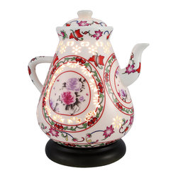 White Ceramic Teapot Luminaire Accent Lamp - This beautiful teapot luminaire adds a lovely accent to any room in your home. Made of ceramic, it measures 9 inches tall, 8 inches long, 6 1/4 inches wide and has a 5 1/4 inch diameter base. Lift the teapot straight up off the base to install or change the lightbulb, you may use either a 15 watt (max) type `B` bulb, or 0.5 watt (max) LED bulb (not included). The brown 5 foot long power cord has a thumb wheel on/off dimmer switch, so you can control the intensity of the light shining through the dainty cutouts in the shade. This lamp is a great addition to accent and end tables, and makes a great gift.