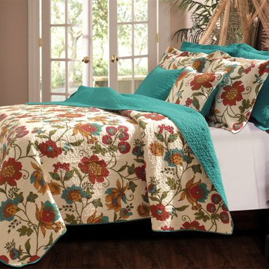 None - Clearwater 3-piece Quilt Set - Flowered vines grace this updated tropical quilt in gold,olive green,red and turquoise on an antique white ground while the fabric bound edges and reverse have an all-over solid turquoise color. The quilt is oversized for deep mattress coverage.