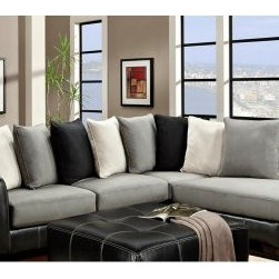 Chelsea Home Landon 2 Piece Sectional - Idol Steel / Laredo Black - Start planning your family gathering, because there's plenty of room for everybody on this spacious Chelsea Home Landon 2 Piece Sectional - Idol Steel / Laredo Black. Coming in a modern and attractive black, gray and white color scheme and ideal for a large family room or perhaps a basement den (read: man cave), combined the two-piece section measures a whopping 119 inches, or nearly 10 feet. It consists of a three-cushion sofa (81 inches wide) and a two-cushion chaise (91 inches long and 38 inches wide) that's perfect for one lucky person to sprawl out on to nap, read a book or take in a movie in pure comfort. Both pieces of the sectional were constructed with a durable hardwood frame covered in sleek black upholstery. All cushions were fashioned with 1.8 density foam and a sinuous spring system that offers a perfect mix of comfort and support. The back seat cushions come in the form over eight oversized pillows (three white, three gray and two black) that can be arranged in a row or as needed. About Chelsea Home FurnitureProviding home elegance in upholstery products such as recliners, stationary upholstery, leather, and accent furniture including chairs, chaises, and benches is the most important part of Chelsea Home Furniture's operations. Bringing high quality, classic and traditional designs that remain fresh for generations to customers' homes is no burden, but a love for hospitality and home beauty. The majority of Chelsea Home Furniture's products are made in the USA, while all are sought after throughout the industry and will remain a staple in home furnishings.