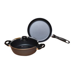 Swiss Diamond - Induction 3 Piece Set: Fry Pan and Casserole - This Swiss Diamond cookware set is perfect when it's time to whip up tasty meals for family and friends. This set has all of the necessary cookware for a housewarming gift or wedding present. It's perfect for preparing some of your favorite meals, from lamb burgers with garlic-yogurt sauce to blueberry french toast. This set contains a 9.5 inch Induction Fry Pan and 9.5 inch Induction Casserole, with a lid that fits both items. Swiss Diamond induction cookware provides superior performance provided by a cast aluminum body and our own diamond reinforced nonstick coating. The durable nonstick coating inside and out provides impeccable food release and makes cleaning up a breeze. The sturdy cast aluminum construction promotes even heating, while eliminating hot spots. Our stay cool handles are comfortable to grasp, plus the sturdy glass lids make it possible to keep an eye on food without having to lift the lid. Oven safe to 500 degrees fahrenheit.