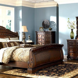 Millwood by ivgStores - 5 Pc Bedroom - North Sea Collection (Queen) - Choose Size: QueenBring a classic look with vintage style design elements to your master bedroom with this ornate traditional bedroom set, featuring a sleigh bed with carved accents and rosette detailing, a dresser and mirror set, a five-drawer chest and a two drawer nightstand. Storage pieces have inlay stone tops. Collection: North Sea. Set includes Headboard, Footboard, Rails, Nightstand, Chest, Dresser, and Mirror. Color/Finish: Dark Brown. Constructed with select hardwood veneers, hardwood solids and furniture grade resin. Dark casual finish. Dark colored metal accents & hardware. Large scale decorative pilasters and ornately detailed appliques. Beveled mirror. Serpentine shaped drawer fronts. Diamond patterned inlay stone veneer tops on dresser and nightstand. Framed drawer fronts. Cedar veneer or felt lined drawer bottoms. Concealed drawers in nightstand and armoire base. Armoire features a pull-out back & adjustable shelves. Mansion sized poster bed with upholstered headboard panel. Inlaid marble veneer caps on panel footboard. Upholstered bench seat. Queen Headboard: 65 in. W x 11 in. L x 62 in. H. Queen Footboard: 67 in. W x 11 in. L x 34 in. H. King/California King Headboard: 82 in. W x 11 in. L x 62 in. H. King/California King Footboard: 84 in. W x 11 in. L x 34 in. H. Nightstand: 36 in. W x 20 in. L x 34 in. H. Chest: 45 in. W x 19 in. L x 54 in. H. Dresser: 74 in. W x 20 in. L x 39 in. H. Mirror: 49 in. W x 5 in. L x 52 in. H