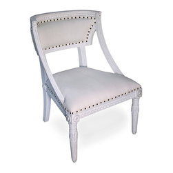 Luis Chair - White Weathered - A simplified klismos outline invokes the classics in your home when you choose the Luis Chair to complete your seating plan in traditional style. The white weathered finish applied to this chair's stunning mahogany frame gives a clean, classical look to a form popularized by craftsmen of the English Regency, while the carvings of the apron allude to architectural detailing.