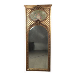 19th Century French Trumeau Mirror - This is a marvellous 19th century French trumeau mirror with an oval oil painting on canvas hand painted of a lady and a cupid in the park. The frame is very heavily carved and topped with bow like designs.