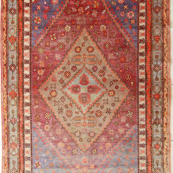 Over-Dyed Makah Multi Rug - Buy a smaller Persian rug to layer over a large jute rug so that you can step out of bed onto a softer rug.