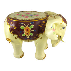 Ornate Elephant Plant Stand Hand Painted - This stunning, hand-painted cold cast resin elephant plant stand is an incredible addition to living rooms, hallways, foyers and dens. The stand features an elephants with metallic gold tusks, flower embellishments on his ears and back, metallic gold edged blanket and has a wonderful antiqued finish. The stand measures 10 1/2 inches tall, 14 inches long and 8 inches wide. The flat part on the back is 8 inches long, 6 inches wide. This beautiful elephant makes a wonderful gift for friends and family. It`s a must have for elephant lovers.
