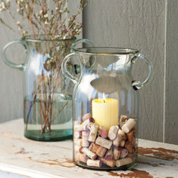 Prospero Glass Candle Vases - These glass vases make a great decor statement and you get to use them in many different ways! I'd fill them with white pebbles and a candle for a more subtle look.