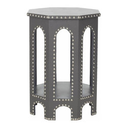 Safavieh - Nara End Table Grey - Inspired by the timeless, romantic feeling of gothic arches, the grey Nara Side Stool offers a contemporary spin on classic style. Crafted with iron nail head detail, its six sides blend geometric form with a fresh, solid palette.