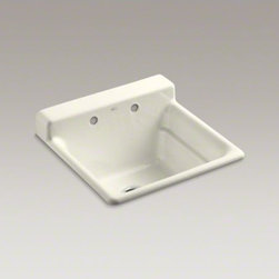 KOHLER - KOHLER Bayview(TM) top-mount utility sink with 2 faucet holes on backwall - The Bayview utility sink helps you take on the toughest tasks at home, be it in the utility room, laundry, kitchen, or garage. A generous 11-inch depth gives you plenty of room to work, and an integrated backsplash helps keep liquids where they belong. Crafted from enameled cast iron, this sink resists scratching, burning, and staining for years of beauty and reliable performance.