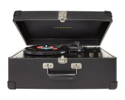 Crosley Radio - Crosley Radio Traveler Turntable, Black - Crosley Radio - Turntables - CR49BK. By the late 50's stereo records reached a peak in the marketplace as hi-fi sound reproduction attained its largest audience to date. The portable turntable was introduced in the late 1950's and provided music lovers with a sense of independence allowing them to easily cart their record player from one locale to another. The popularity of this unit was due in no small part to its portability but also to its suitcase styled finishing touches that became a Crosley hallmark. The crosley traveler turntable is designed to reflect the portable styling's of yesteryear. This fan favorite is a 3 speed belt driven turntable that plays 33 1/3, 45 and 78 RPM records. The Traveler includes modern conveniences such as a diamond stylus needle and dynamic full range stereo speakers. So whether you choose Ella Fitzgerald or Elvis celebrate your vinyls in portable style.