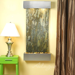 Slate Wall Mounted Water Features - The Cascade Springs with Green Slate - At just $1,449 with its hand chiseled China Green Slate or Indian Red Rajah Slate, the Cascade Springs wall fountain is the perfect way to distinguish your space from the rest. This interior or exterior wall water wall displays a rustic finish and illuminating light above, making the Cascade Springs wall mounted water fountain an earthy & delightful piece that will leave your guests or clients in awe. Become the envy or your entire neighborhood with this amazing water feature. The Cascade Springs indoor wall fountain is hand crafted to perfection this piece is available in two types of Slate, with three finish options and two corner styles. The Cascade Springs wall fountain is the perfect size water feature for your home, not too large and not too small, this water fountain will hang beautifully from any wall.