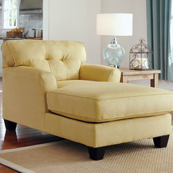Signature Design by Ashley - Signature Design by Ashley Kylee Goldenrod Linen Chaise Lounge - Add rich,warm color to your living room with this stately goldenrod chaise lounge. With a button-tufted back,gently curved arms and a long lounging surface,this plush chair will brighten any decor motif with inviting style.
