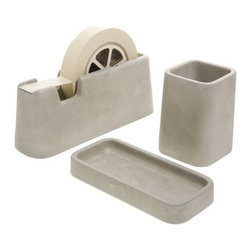 Areaware - Concrete Desk Set by Areaware - Give your work some real weight with the Areaware Concrete Desk Set by Magnus Pettersen. It includes a tape dispenser, pencil holder and a small tray, all made out of cement. The smooth texture and soft grey tone of the set makes as pleasant to look at as it is to use. Areaware reinvents the everyday object with a more eccentric and absurdist twist, driven by a fascination about forward thinking technologies and original expression. A New York-based company, Areaware is dedicated to creating not just useful design accessories, but poetic objects that inspire an emotional response.