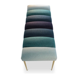 """Recovered Interior Collection - The Chromatic Bench packs a visual punch by using the channel tufts to emphasize the four complementary colors in a gradient pattern. Felted wool in shades of fuchsia, blue, green and gray are the color choices offered. The polished brass legs finish the look of this modernly elegant bench. Perfect at the end of the bed, as a dinner table bench, in an entry way or an accent in your living room. DIMENSIONS: 48"""" x 19"""" x 19"""" H - See more at: http://recoveredinterior.com/shop/chromatic-bench.html#sthash.Ys2o17wv.dpuf"""