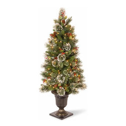 4 Ft. Pine Entrance Christmas Tree w/ Snowflakes & 50 Clear Lights - Measures 4 feet tall with 22 inch diameter. Indoor or outdoor use. Pre-lit with 50 UL listed, pre-strung Clear lights. Tip count: 162. Decorative urn base. Features cones, red berries and snowflakes. Light string features BULB-LOCK to keep bulbs from falling out. If one bulb burns out the others remain lit. Includes spare bulbs and fuses. Fire-resistant and non-allergenic. Packed in reusable storage carton.