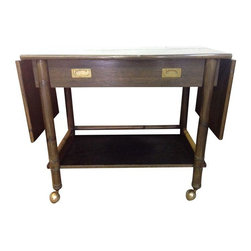 John McGuire - Pre-owned McGuire Bamboo Bar Cart - Serve your gin gimlets and old fashioneds in style on this mid-century bamboo bar cart by McGuire. This conversation piece is mobile, yet sturdy enough to hold all of your bar necessities and can be extended to over 5 feet long.  The divided drawer with campaign hardware is an added bonus!  Normal vintage wear with some light surface scratches on the top and bottom shelves and wear on the casters.