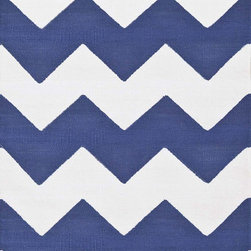 Chevron Denim/White Indoor/Outdoor Rug - Crisp zig-zags and the lively denim-and-white combination shake up the classic striped rug with a bold, modern graphic twist. This exceedingly popular motif stylizes a room with modern verve, and the calming yet vibrant shade can anchor a room in the manner of a neutral or set the tone for a bold arrangement of bright colors and patterns. The lightweight polypropylene construction promises all-season versatility.
