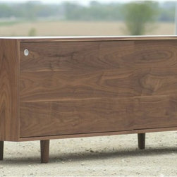 Eastvold Classic Credenza - Classic Credenza by Eastvold. Solid wood and smooth sliding hardware make this Mid-Century inspired piece a new Classic. The Eastvold Classic Credenza features sliding grain matched doors and inner shelving. Wire passage holes make this an incognito media cabinet. The credenza is crafted from solid wood and is made right here in the USA.