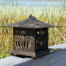 Dragonfly Tea Lantern - Dragonflies seem to dance under the warm glow of a tea light candle in this Dragonfly Tea Lantern. The pagoda inspired design features dragonflies and reeds and a hinged door allows easy access to renew the candle. Cast aluminum construction and weather-resistant finish allows you to enjoy this attractive accent, indoors or out, year after year. This lantern may be hung or stand alone. Some assembly is required.