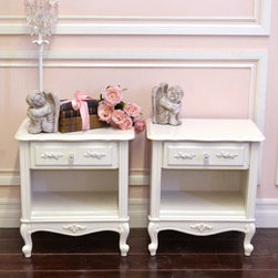 Lovely Pair of Shabby White Nightstands with 1 Drawer - What a stunning pair of nightstands! Features one drawers and open shelf with rose appliques and clear, glass knobs decorating the face. Lovely scroll feet. Great for any shabby chic style bedroom. See photos. Made by Lea: The Furniture People.