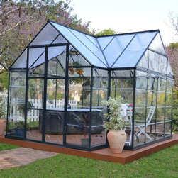 Palram - Palram Chalet Greenhouse Kit - HG5400 - Shop for Greenhouses from Hayneedle.com! Grow your favorite plants and vegetables even when it's colder outside with the Palram Chalet Greenhouse Kit. Beautiful and sophisticated this cathedral design is just as practical as it is elegant. Vaulted ceilings not only provide plenty of headroom and working space but also allows for plenty of space for trellising. Crafted from strong and durable polycarbonate with a rust-resistant aluminum frame galvanized steel base and UV protection this low maintenance greenhouse is made to last. Two vent windows and hinged double doors provide abundant airflow throughout your greenhouse helping your plants to grow and thrive. Additional Features Sidewall: 64.5 inches Peak Height: 105 inches Includes a galvanized steel base High head room for added comfort and space No glass to shatter or break Sophisticated cathedral design Vaulted ceilings allows for trellising 2 vent windows and hinged double doors Allows for abundant airflow Polycarbonate glazing is virtually unbreakable Low maintenance design