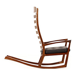 EcoFirstArt - Kalifornia Rocker - You won't ever want to get up from this chair that feels as luxurious embracing your body as it looks magnificent to behold. Eight ladder-back style rungs lovingly cradle your spine as you gently rock into complete relaxation, while a sleek, black-cushioned seat provides the final touch of bliss. Available in walnut, cherry or white oak finishes — though the truly adventurous may be more apt to customize in red.