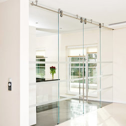 """Full Glass Sliding Doors - """"Twin"""" - Twin – Modern Barn Door Hardware is suitable for single or double bi-parting applications. The rail may be mounted to the wall, ceiling or stationary glass. Twin's double wheel design allows the door to reach from floor to ceiling making this most appropriate for ceiling mounted installations. Twin hardware is for use with both frameless glass or wood doors."""