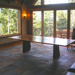 Natural Edge in Telluride, Colorado - This photo was taken as soon as the table had been delivered and assembled. The wood slab base was chosen and the shot was taken before the chairs restricted the full view. No doubt, an heirloom piece to be treasured.