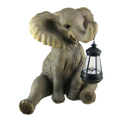 Cute African Elephant Porch / Garden Statue with Lantern - This incredibly cute sitting African Elephant statue carries a lantern in his trunk powered by 2 AA batteries (not included). Made of cold cast resin, the elephant measures 13 1/2 inches tall, 14 1/2 inches wide and 10 inches deep. He's hand-painted, and shows great detail. He looks great in gardens, flowerbeds and on porches. This statue makes a wonderful gift for any elephant lover.