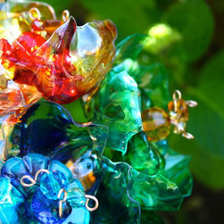 Chihuly-Like Garden Art Yard Flower Stakes by Arte Plastique, Set of 3 - This Etsy seller re-imagines plastic bottles into Chihuly-inspired garden sun catchers.