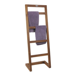 "Aqua Teak - Angled Teak Towel Stand - From the Spa Collection - This gorgeous teak shower stand or teak pool rack is handcrafted using sustainably harvested solid teak wood. The OptiArea�� space saving design makes it extremely convenient for any compact location without sacrificing functionality. Whether indoors or outdoors, this naturally water resistant teak towel rack is the perfect accessory for your home! Aqua Teak offers a 30 day satisfaction guarantee and 5 year warranty on all products. (Some assembly required) Dimensions: 15.8""w x 44""h x 9.5""d"