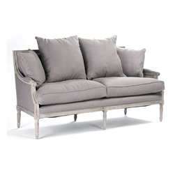 Kathy Kuo Home - St. Germain French Country Limed Oak Louis XVI Gray Linen Sofa - Stately with gorgeous, delicate features - this limed grey oak sofa harkens back to a luxurious, stylish time.  The French country St. Germain sofa is upholstered in soft, cushiony linen with four extra pillows that allow you to style it precisely to your level of comfort.  Loosen your corset and recline after a long day of croquet on the great lawn (or your belt, after a long day of chasing the kids in the yard).