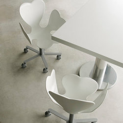 Edra - Edra Fortuna Desk Chair - This four leaved clover shaped chair is formed from a compact foam. The base is chromed metal and includes wheels. The seat is available lacquered in a wide range of colors or padded and upholstered in fabric. The Fortuna Desk chair is part of a collection that includes a dining chair and bench seating. Price includes delivery to the USA. Manufactured by Edra.Designed in 1996.
