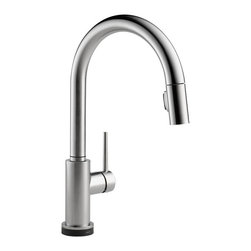 "Delta - Delta 9159T-AR-DST Trinsic Series Deck-Mounted Pull-Down Kitchen Faucet - The Delta 9159T-AR-DST is a Trinsic Series Deck-Mounted Pull-Down Kitchen Faucet. This deck-mounted pull-down kitchen faucet features a Two-Function pull-down spout sprayer, a solid brass fabricated body, and a single lever handle for precise temperature and volume control. This model has a 15-11/16"" tall 9-1/2"" long spout, and a Touch-Clean spray head that allows for less mineral build-up. Itcomes with a MagnaTite docking system, and dual integral check valves in the sprayer for less backflow. This faucet also comes with an optional 10-1/2"" keyed escutcheon for an easier installation, and a 1.8 GPM flow rate. This faucet is ADA and CalGreen compliant, and it features Delta's Touch20 Technology for easy on/off functioning when you don't have hands to turn the handle. This model comes in a brilliant, Arctic Stainless Steel finish."