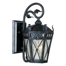 Maxim Lighting - Maxim Lighting Canterbury Forged Iron Traditional Outdoor Wall Sconce - Bring the Old World to your front porch or backyard with the Maxim Lighting Canterbury Forged Iron Traditional Outdoor Wall Sconce! Exuding a classic flavor, this light fixture is constructed with forged metal and finished in Artesian Bronze for an aged look. Panels of Seedy glass enhance the light, while leafy motifs and wire accents allude to traditional styles.