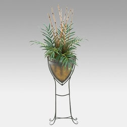 Kentia Palm and Bamboo Cane in Metal Shield Planter with Stand - Decorate a drab floor with the Kentia Palm and Bamboo Cane in Metal Shield Planter with Stand. It features lush green palm leaves with bamboo stalks for a unique look. Realistic palm fronds and bamboo canes feature lifelike texture. Resembling a shield the metal planter enhances the sophisticated look. The arrangement measures 18W x 96H inches and weighs 11 pounds. About D & W Silks Inc.D & W Silks imports and manufactures interior silk foliage trees floral arrangements and plants for wholesale customers. Founded by E.M. Deeley the Louisville Ky.-based company is led by sons Chris and Sean. They continue their father's commitment to providing superior customer service and creating the latest styles of high quality silk foliage for interior designers and the furniture industry.