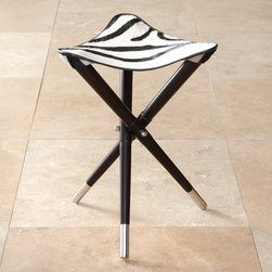 "Global Views - Global Views Elegant Hair on Zebra Camp Stool - Modern style takes a striking stance with the elegant tripod design of the Global Views camp stool. A textured zebra cowhide seat tops black criss-crossing legs accented in silver for a restful spot with exotic refinement. 15""W x 15""D x 19""H; Cowhide; Nickel finish; Made of natural materials and shipped with recyclable packaging"