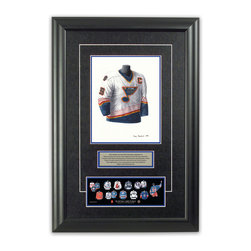 "Heritage Sports Art - Original art of the NHL 1995-96 Wayne Gretzky jersey - This beautifully framed piece features an original piece of watercolor artwork glass-framed in an attractive two inch wide black resin frame with a double mat. The outer dimensions of the framed piece are approximately 17"" wide x 24.5"" high, although the exact size will vary according to the size of the original piece of art. At the core of the framed piece is the actual piece of original artwork as painted by the artist on textured 100% rag, water-marked watercolor paper. In many cases the original artwork has handwritten notes in pencil from the artist. Simply put, this is beautiful, one-of-a-kind artwork. The outer mat is a rich textured black acid-free mat with a decorative inset white v-groove, while the inner mat is a complimentary colored acid-free mat reflecting one of the team's primary colors. The image of this framed piece shows the mat color that we use (Medium Blue). Beneath the artwork is a silver plate with black text describing the original artwork. The text for this piece will read: This original, one-of-a-kind watercolor painting of Wayne Gretzky's 1995-96 St. Louis Blues jersey is the original artwork that was used in the creation of this Wayne Gretzky jersey evolution print and tens of thousands of Wayne Gretzky products that have been sold across North America. This original piece of art was painted by artist Tino Paolini for Maple Leaf Productions Ltd. Beneath the silver plate is a 3"" x 9"" reproduction of a well known, best-selling print that celebrates Wayne Gretzky's hockey history. The print beautifully illustrates a chronological evolution of some of Wayne Gretzky's jerseys and shows you how the original art was used in the creation of this print. If you look closely, you will see that the print features the actual artwork being offered for sale. The piece is framed with an extremely high quality framing glass. We have used this glass style for many years with excellent results. We package every piece very carefully in a double layer of bubble wrap and a rigid double-wall cardboard package to avoid breakage at any point during the shipping process, but if damage does occur, we will gladly repair, replace or refund. Please note that all of our products come with a 90 day 100% satisfaction guarantee. Each framed piece also comes with a two page letter signed by Scott Sillcox describing the history behind the art. If there was an extra-special story about your piece of art, that story will be included in the letter. When you receive your framed piece, you should find the letter lightly attached to the front of the framed piece. If you have any questions, at any time, about the actual artwork or about any of the artist's handwritten notes on the artwork, I would love to tell you about them. After placing your order, please click the ""Contact Seller"" button to message me and I will tell you everything I can about your original piece of art. The artists and I spent well over ten years of our lives creating these pieces of original artwork, and in many cases there are stories I can tell you about your actual piece of artwork that might add an extra element of interest in your one-of-a-kind purchase."