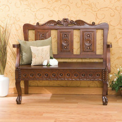 """Wildon Home � - Vernon Handcarved Wood Entryway Storage Bench - This beautifully crafted storage settee is laced with exquisite detail hand carved into solid wood. The seat back is topped with a floral centerpiece embraced by symmetrical scrolls that lay groundwork for the heavily carved floral patterns on three panels set into the seat back. The seat itself opens to reveal hidden storage for blankets, crafts, or other miscellaneous items. On the face of the seat there is additional carving that is comprised of circular medallions in a horizontal repeating pattern. The detail is finished off with the front legs that are hand carved to give the appearance of rivets on top with a traditional clawed foot design on bottom. This bench is truly one of a kind and is sure to be a prized possession in your home. Features: -Made of camphor wood.-Hidden storage area for blankets, crafts or other miscellaneous items.-Beautifully hand carved.-Seating Capacity: 2.-Arms Included: Yes.-Back Included: Yes.-Number of Items Included: 1.-Cushions Included: No.-Lid Included: Yes -Hinged: Yes.-Safety Hinge: No..-Skirted: No.-Slipcover: No.-Upholstered: No.-Stackable: No.-Foldable: No.-Tray Included: No.-Powder Coated Finish: No.-Storage Included: Yes -Number of Storage Compartments: 1..-Material: Camphor wood.-Solid Wood Construction: Yes.-Outdoor Use: No.-Legs Included: Yes -Leg Material: Wood.-Removable Legs: No..-Swatch Available: No.-Commercial Use: No.-Finish: Dark mahogany.-Hand Painted: No.-Distressed: No.-Recycled Content: No.-Eco-Friendly: No.-Product Care: Wipe with a clean dry cloth.-Number of Baskets: 1.Specifications: -FSC Certified: No.Dimensions: -Overall Height - Top to Bottom: 34"""".-Overall Width - Side to Side: 39.5"""".-Overall Depth - Front to Back: 19"""".-Seat Height: 16"""".-Arms: Yes.-Legs: Yes.-Storage Compartment: -Storage Compartment Height - Top to Bottom: 3.5"""".-Storage Compartment Width - Side to Side: 34.5"""".-Storage Compartment Depth - Front to Back: 15.5""""..-Overall P"""