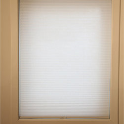 None - Chicology Whisper White Cordless Cellular Window Shade - This Chicology cordless cellular window shade is energy efficient and helps to insulate your home while providing a timeless look for your window and room. Besides offering light control and privacy, the shade is also cordless.