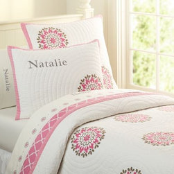 Dahlia Medallion Quilted Bedding - Even Pottery Barn is jumping on the suzani bandwagon. I actually really like this duvet because it is mostly white, so the suzani patterns actually look more like large floral bursts.