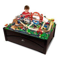 KidKraft Metropolis Train Set Table with Trundle Drawer - Let your child's imagination roll with the Metropolis Train Table and Set from KidKraft. The table brings play time up off the floor and puts a whole city at your child's fingertips. A two-tier bridge a mountain complete with drive-through tunnel and even an airport with a helipad set this apart from the boring old circular train sets. A large rolling trundle under the table top provides plenty of convenient storage space for extra train set pieces or other toys. The espresso finish will look great with any child's room decor and wipes clean with a damp cloth and mild dish soap. With plenty of features quality materials and handcrafted design the Metropolis Train Table and Set may even tempt Mom and Dad to get in on the fun. Airport with helipad Espresso finish Includes 100-piece train set Step-by-step detailed assembly instructions 46.5L x 32.75W x 16.63H inches About KidKraftKidKraft is a leading creator manufacturer and distributor of children's furniture toy gift and room accessory items. KidKraft's headquarters in Dallas Texas serves as the nerve center for the company's design operations and distribution networks. With the company mission emphasizing quality design dependability and competitive pricing KidKraft has consistently experienced double-digit growth. It's a name parents can trust for high-quality safe innovative children's toys and furniture.