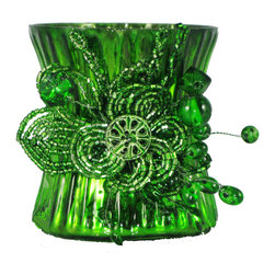Mercury Glass Beaded Emerald Green Votive Holder - Proof that a little romance has the power to transform things, everywhere. Whether you light up a summer picnic under the stars, line them up along the hallway shelf, illuminate a holiday mantelpiece or grace your next dress-up dinner table, these votives will offer a glimmering and glamorous spark of interest.