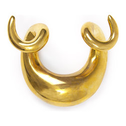 Brass Horn Hook - Jonathan Adler: Brass Horn Hook Modeled after our porcelain horn sculptures, our Brass Horn Hook is a tough piece of hardware. Crafted from solid brass and perfectly perched to hold any coat or jacket.Every piece in our collection of brass bibelots is sand cast in solid brass then polished to perfection by hand. Like a fine wine or your favorite leather jacket, our brass only gets better with age. Over time, the polished brass will develop a rich natural patina. If desired, buff out fingerprints and surface scratches with a dollop of brass polish and a microfiber cloth.