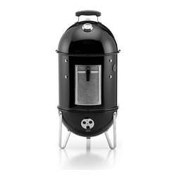 Weber® Smokey Mountain Cooker - Smoke your own deeply flavorful foods with this mid-size water smoker from the wizards at Weber. With 286 square inches of cooking space, the Smokey Mountain can accommodate two 7–9 pound briskets or pork shoulders, four whole chickens, or three slabs of ribs (if cut in half or rolled). Features include an external thermometer for temperature monitoring, a porcelain-enameled water pan to keep foods moist, and a rust-resistant aluminum fuel door for adding charcoal or wood chips. A smart silicone grommet allows insertion of a thermometer to read internal temperatures without opening the door; a premium nylon cover is included to help withstand the elements.