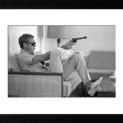 "Photos.com by Getty Images - Steve McQueen Takes Aim - Black & White Framed Photograph, 46 X 34"" - Profile view of Steve McQueen (1930 - 1980) taking aim on a sofa in his Palm Springs, CA home, May 1963. (Photo by John Dominis/The LIFE Picture Collection/Getty Images).  Giclee print on archival paper under glass.  Available in four sizes."
