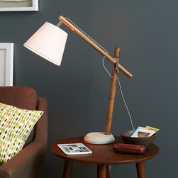 Adjustable Wood Task Lamp - There are so many lovely textures going on with this lamp: rough wood body, cement base and white linen shade. They're all blended together so perfectly in one little piece.