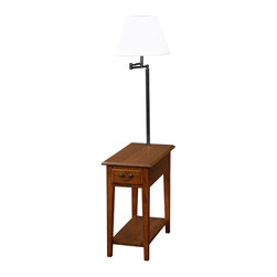 Leick Furniture - Chairside Lamp Table - Medium Oak - This chairside silhouette stands at your service beside recliners and upholstery where space is short. Layered with useful features rising up from the open display shelf, enclosed drawer storage, durable solid wood top, and finally the convenient, swing arm lighting at the perfect height for reading. Solid hardwood. Knockdown, two cartons. Bell shaped, Ecru shade. Antique black finish on drawer pull and lamp components. Medium oak finish.